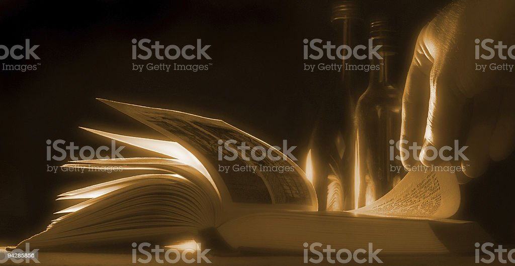 Hand leafing through a book royalty-free stock photo