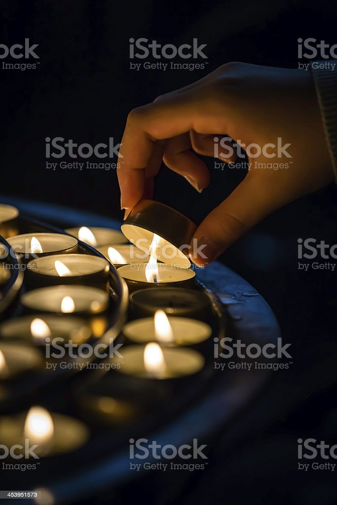 Hand lighting candle royalty-free stock photo