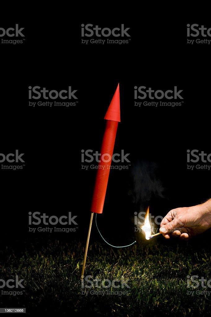 Hand lighting red Rocket/Fireworks fuse stock photo