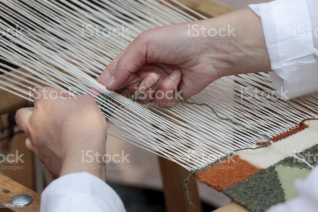 Hand loom weaver's hands stock photo