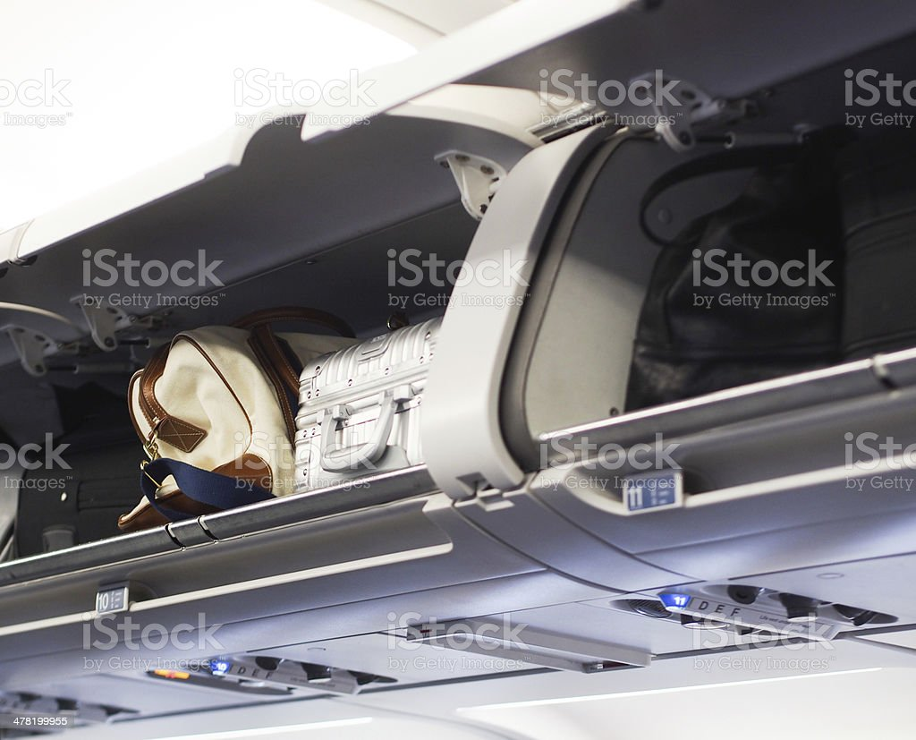 Hand luggage compartments stock photo