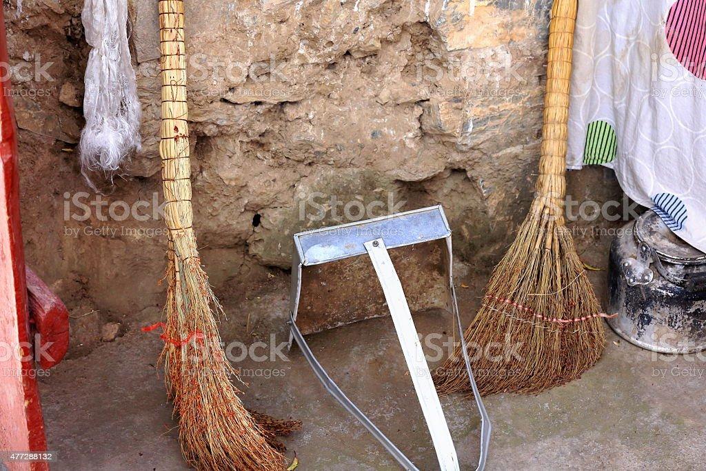 Hand made brooms-metallic dustpan. Drak Yerpa monastery-Tibet. 1511 stock photo
