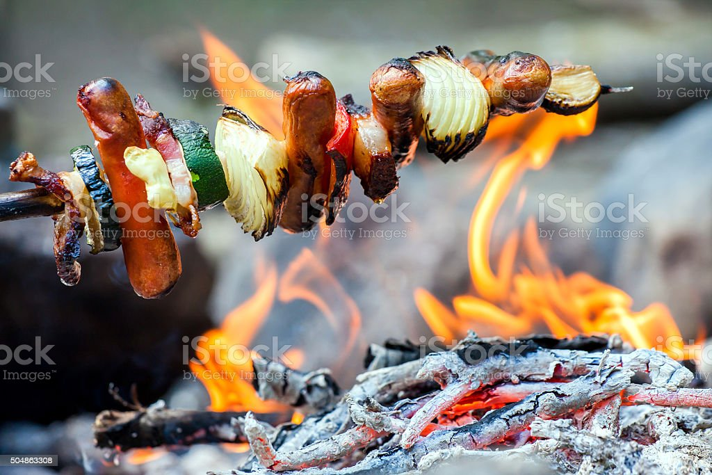 Hand made cooking on campfire. stock photo