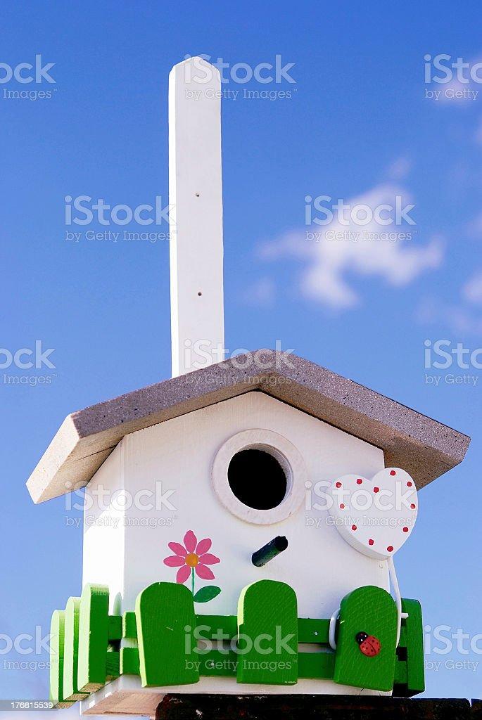 Hand made creative nestling box on sky blue background royalty-free stock photo