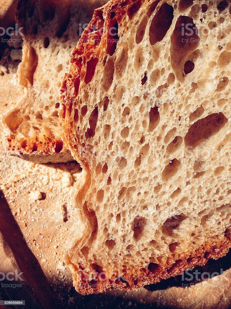 Hand made crusty bread slice stock photo