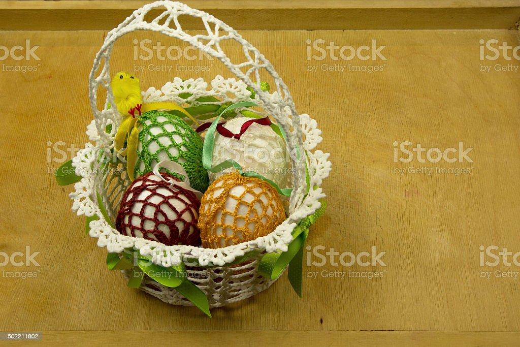 Hand made Easter basket on a wooden table stock photo