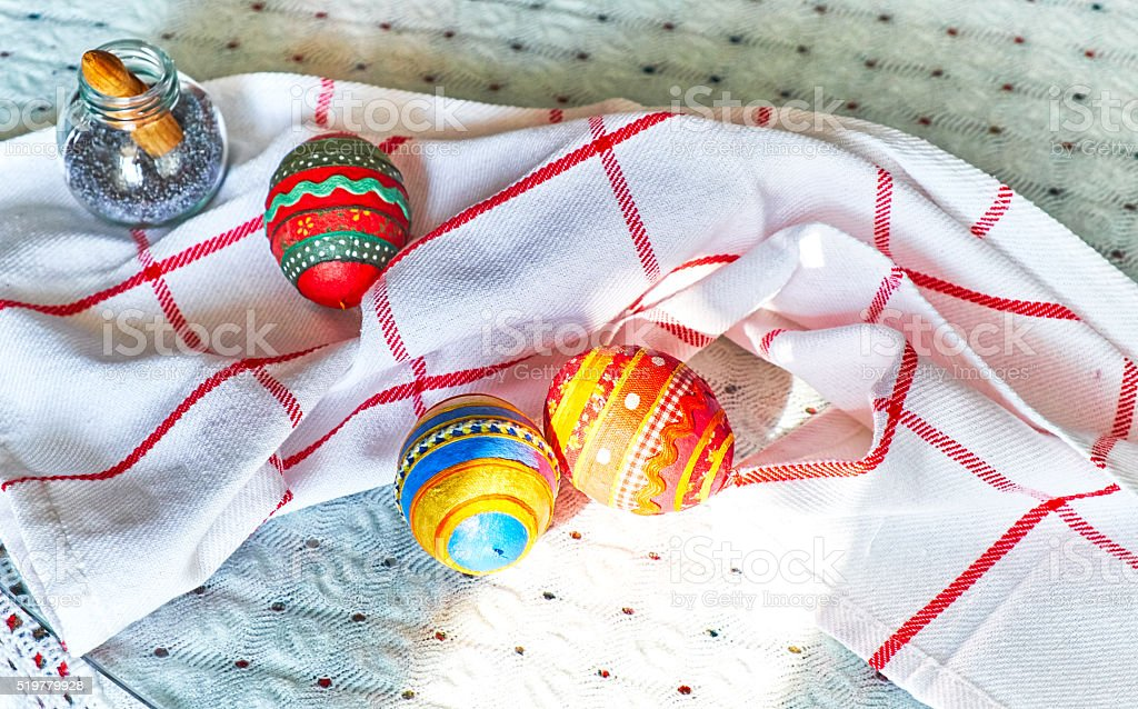 Hand made Easter eggs with embroidered patterns on kitchen table stock photo
