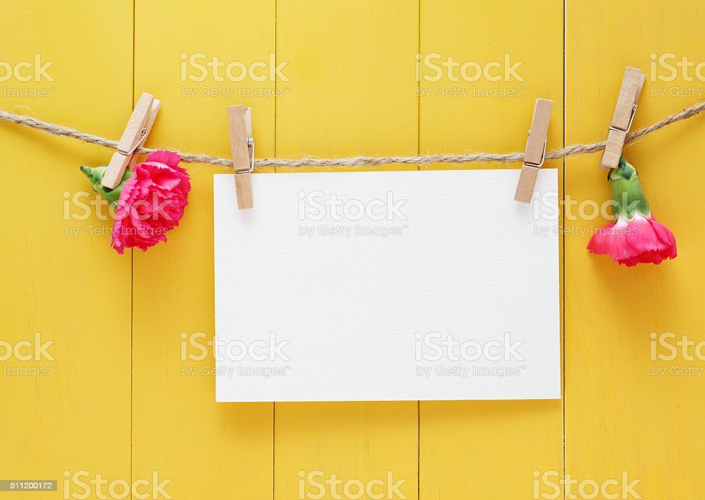 Hand made greeting card on yellow wood background stock photo