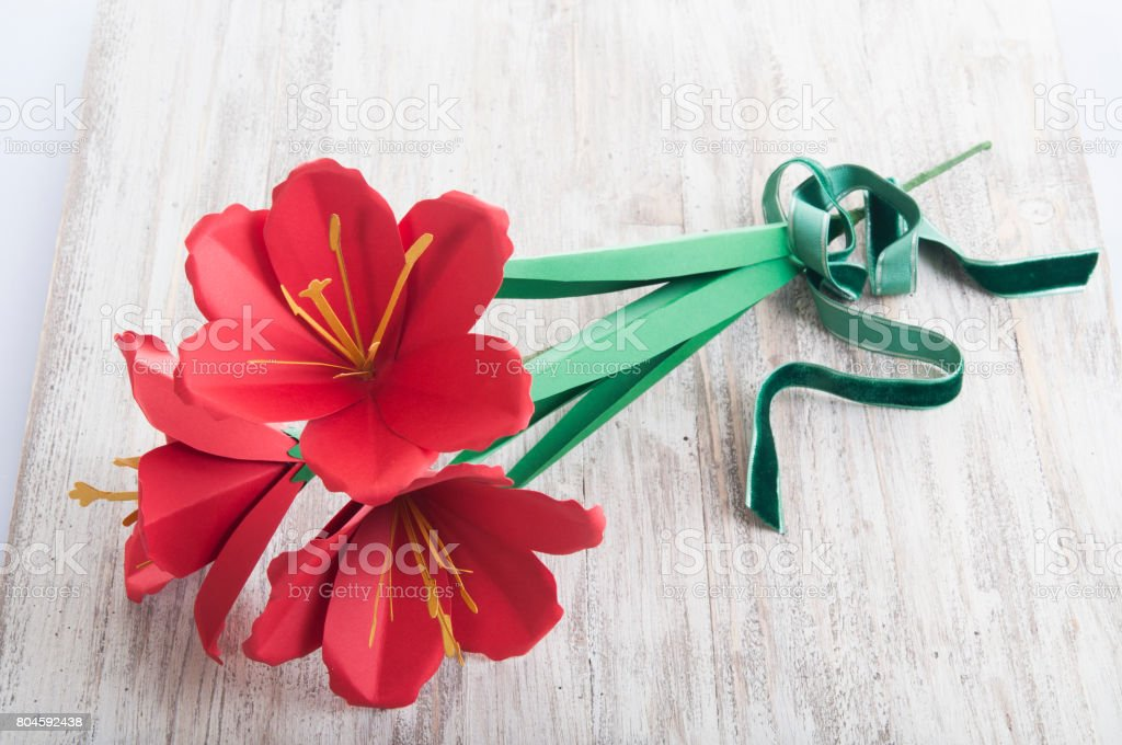 hand made paper red Amaryllis flower stock photo