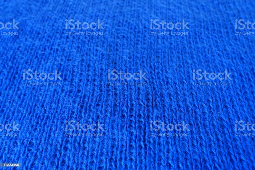 Hand made plain bright blue knitted fabric stock photo