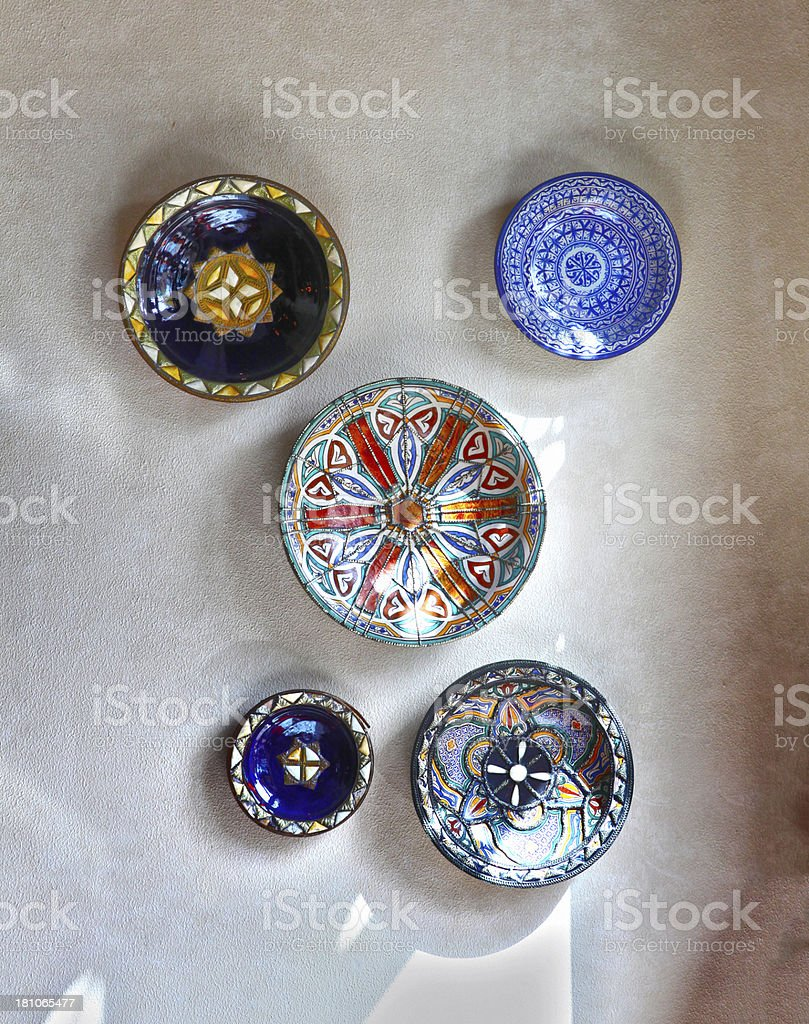 hand made pottery plates art hanged on wall stock photo