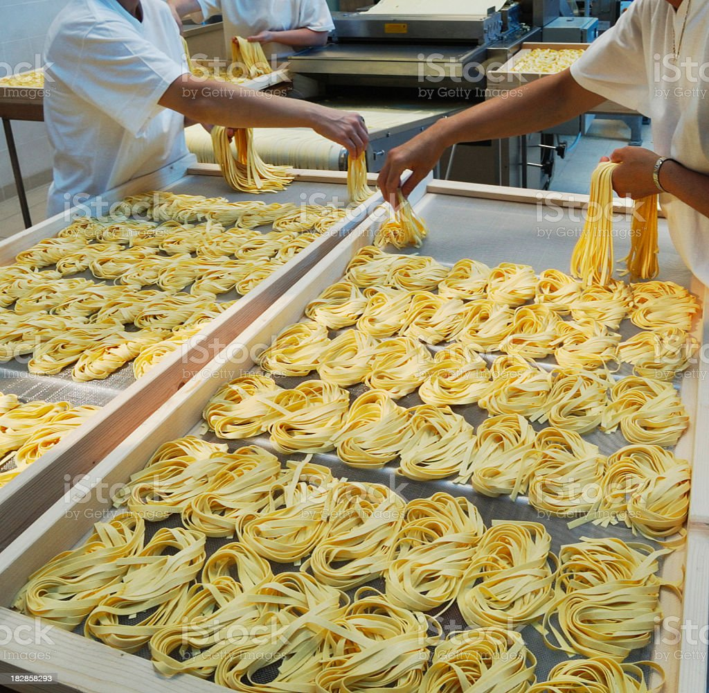 Hand made production of  tagliatelle (italian pasta) stock photo