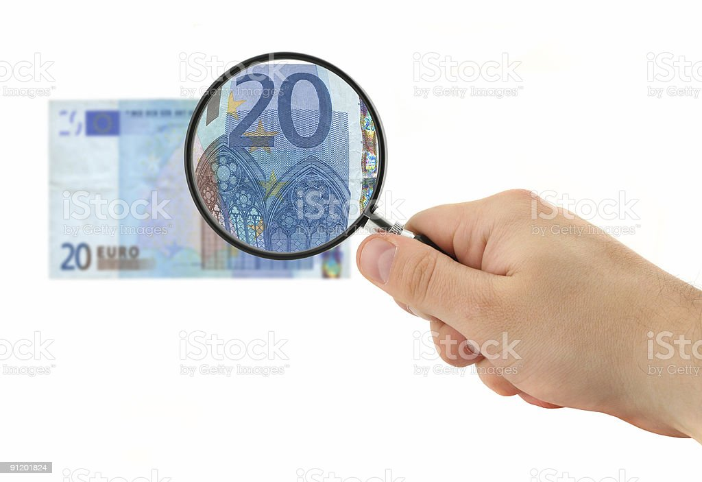 hand magnifying 20 Euro note royalty-free stock photo
