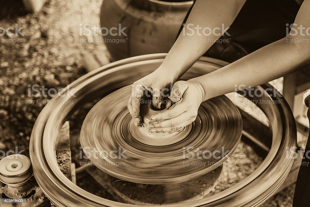 hand making a clay or mud pot , hand made concept. stock photo