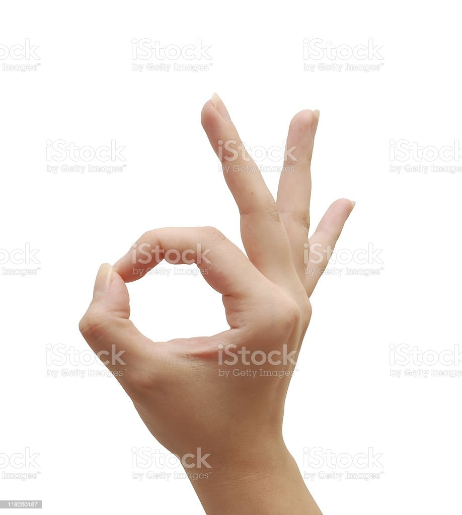Hand making a gesture signaling ok stock photo