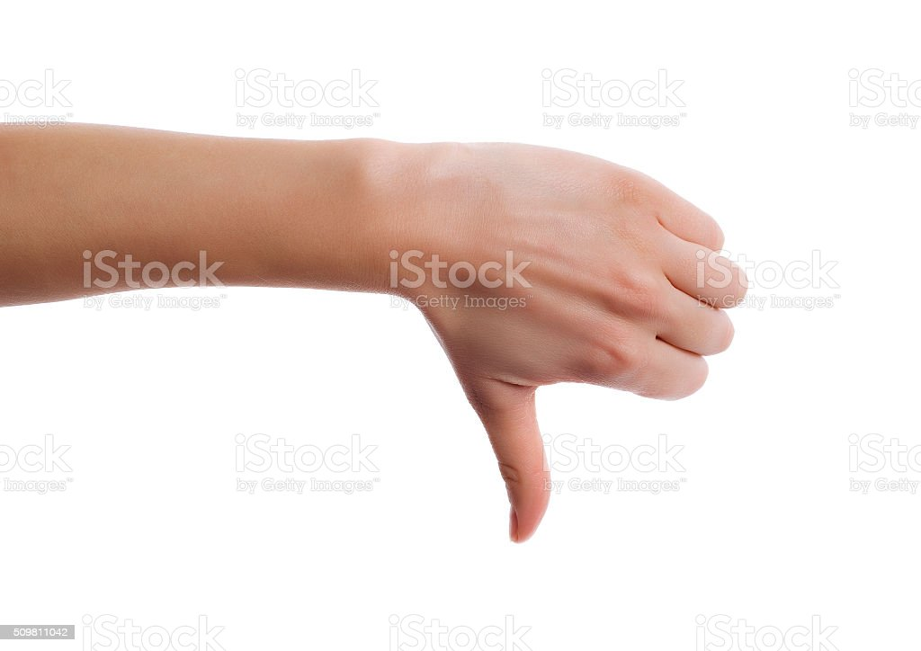 Hand making a thumbs down gesture. stock photo