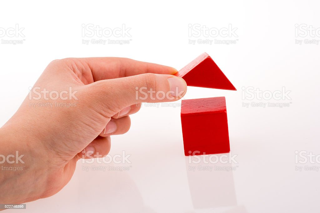 Hand making house with cubes stock photo