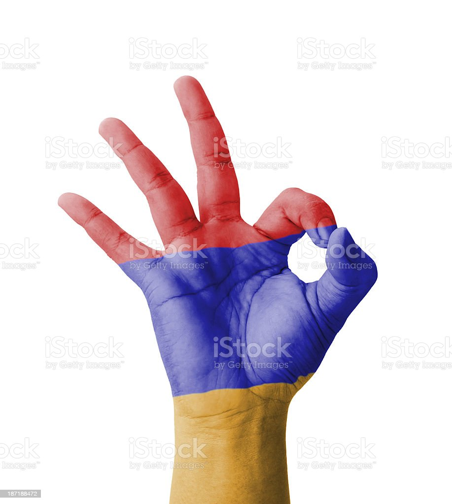 Hand making Ok sign, Armenia flag painted stock photo