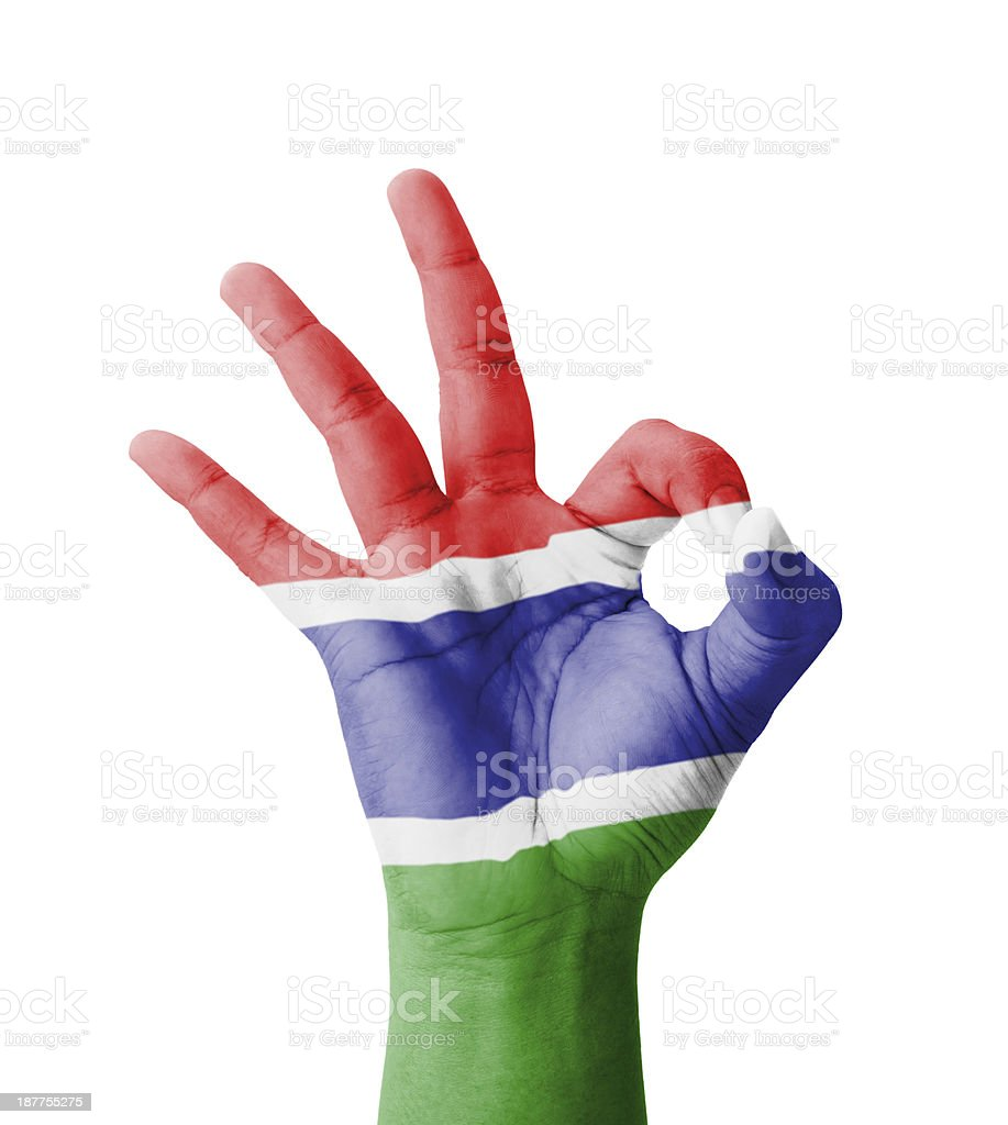 Hand making Ok sign, Gambia flag painted royalty-free stock photo