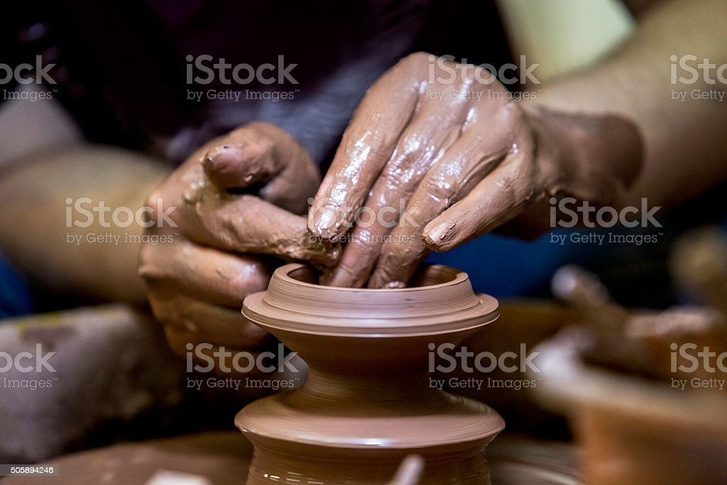 hand making pottery tea cup stock photo