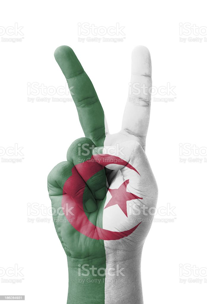 Hand making the V sign, Algeria flag painted stock photo
