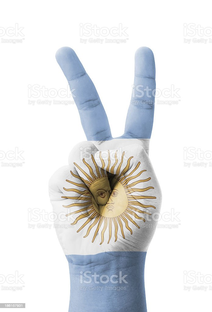 Hand making the V sign, Argentina flag painted stock photo