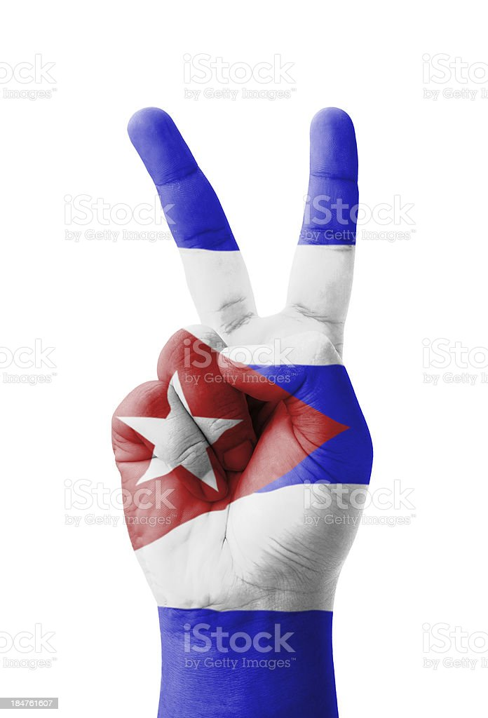 Hand making the V sign, Cuba flag painted stock photo