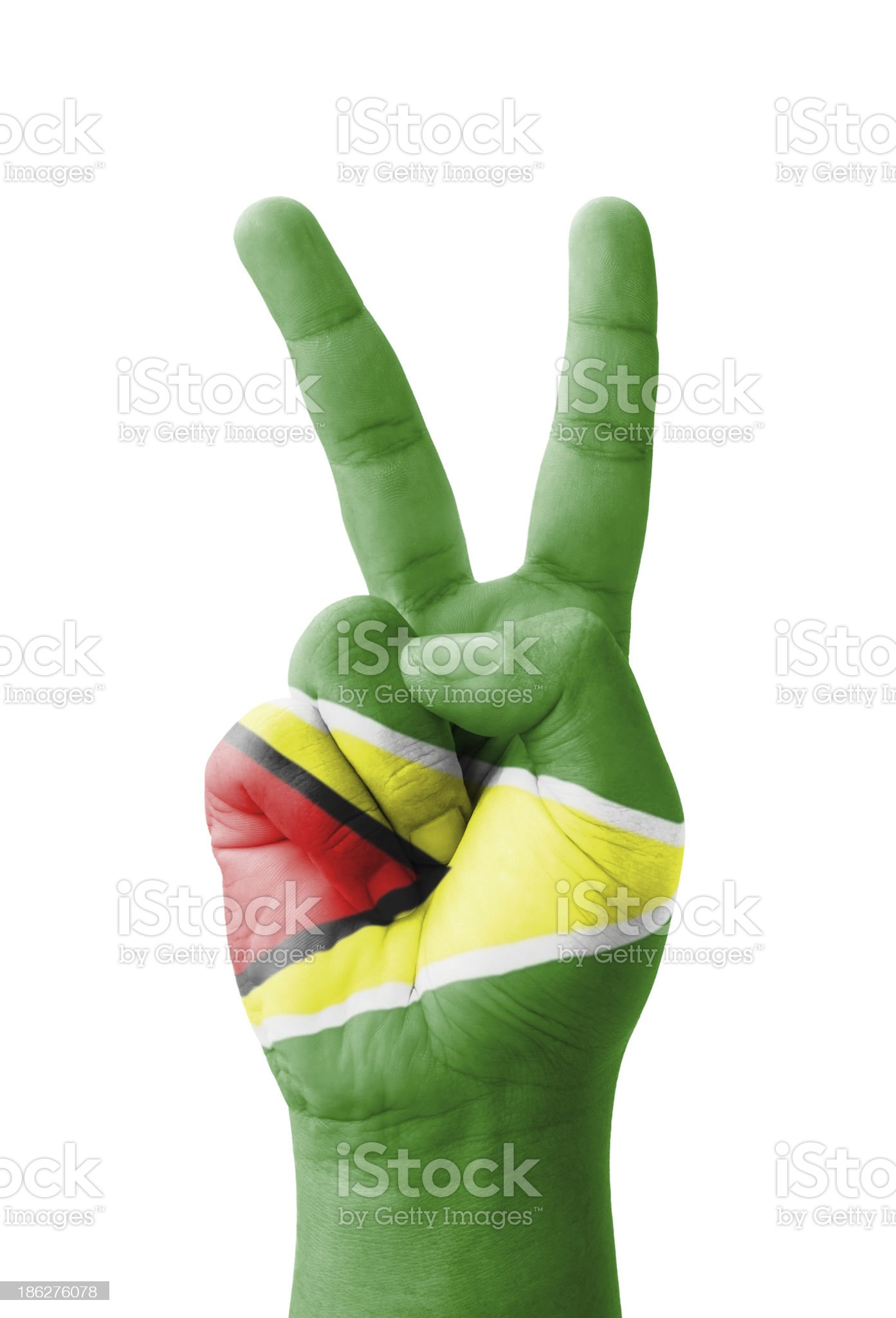 Hand making the V sign, Guyana flag painted royalty-free stock photo