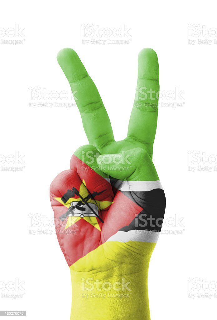 Hand making the V sign, Mozambique flag painted royalty-free stock photo