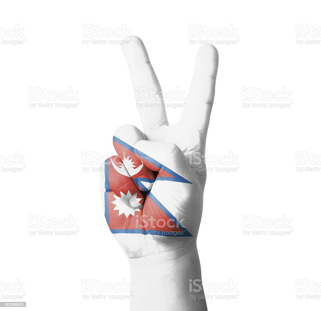 Hand making the V sign, Nepal flag painted stock photo