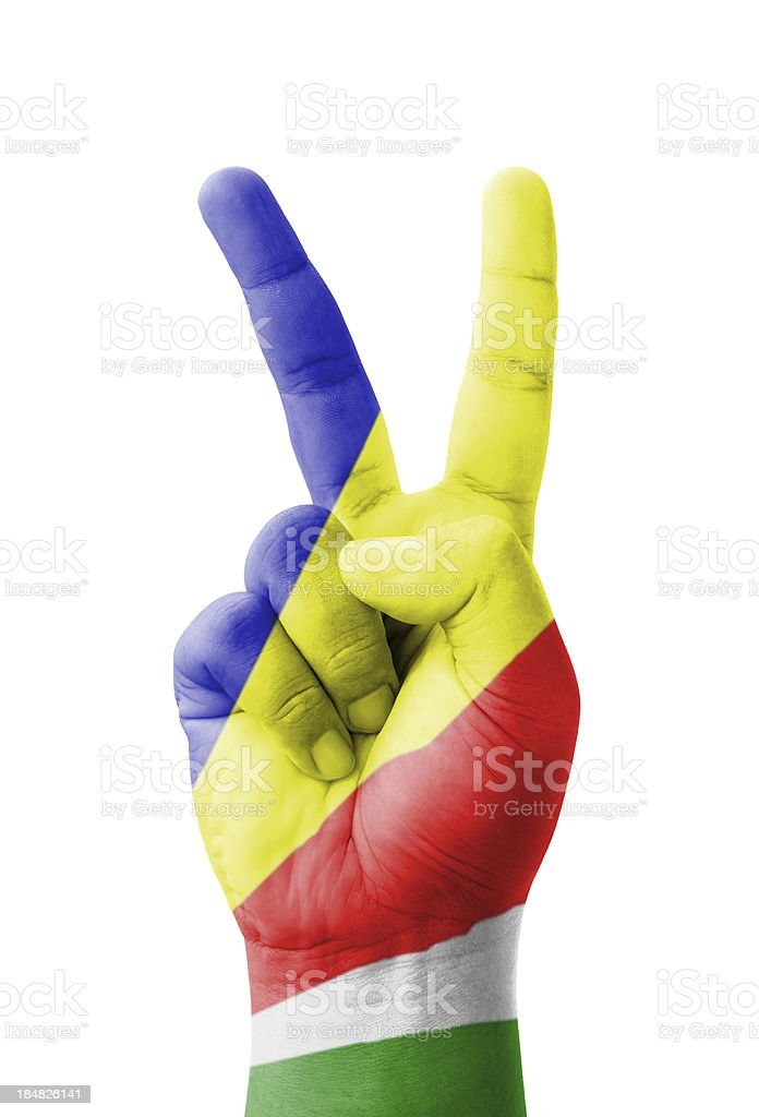 Hand making the V sign, Seychelles flag painted royalty-free stock photo