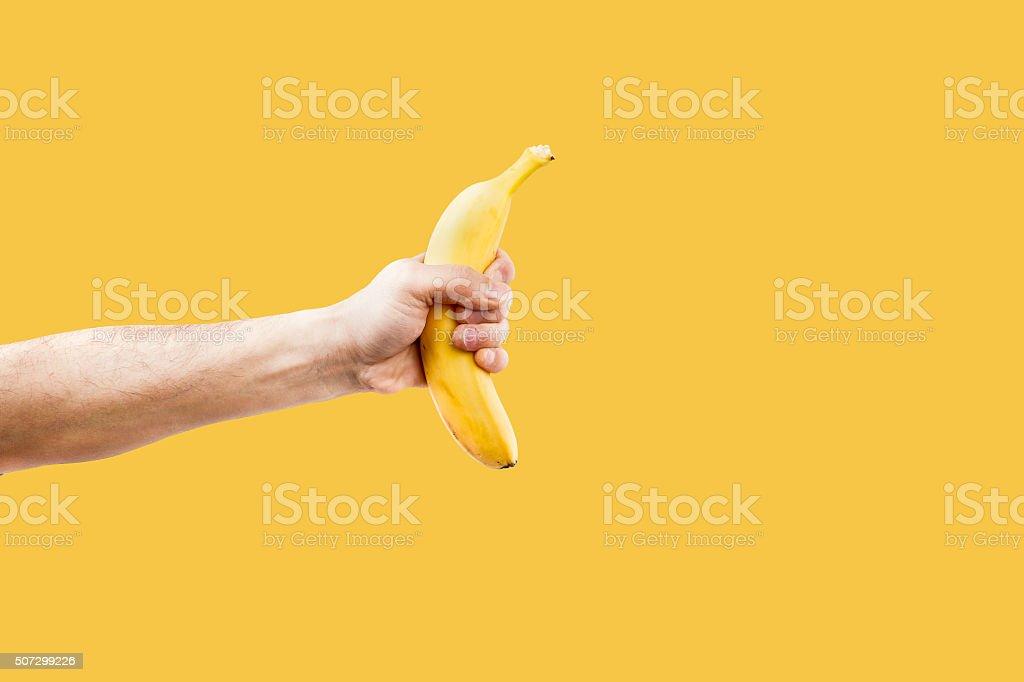 Hand male holding a shape banana telephone. stock photo
