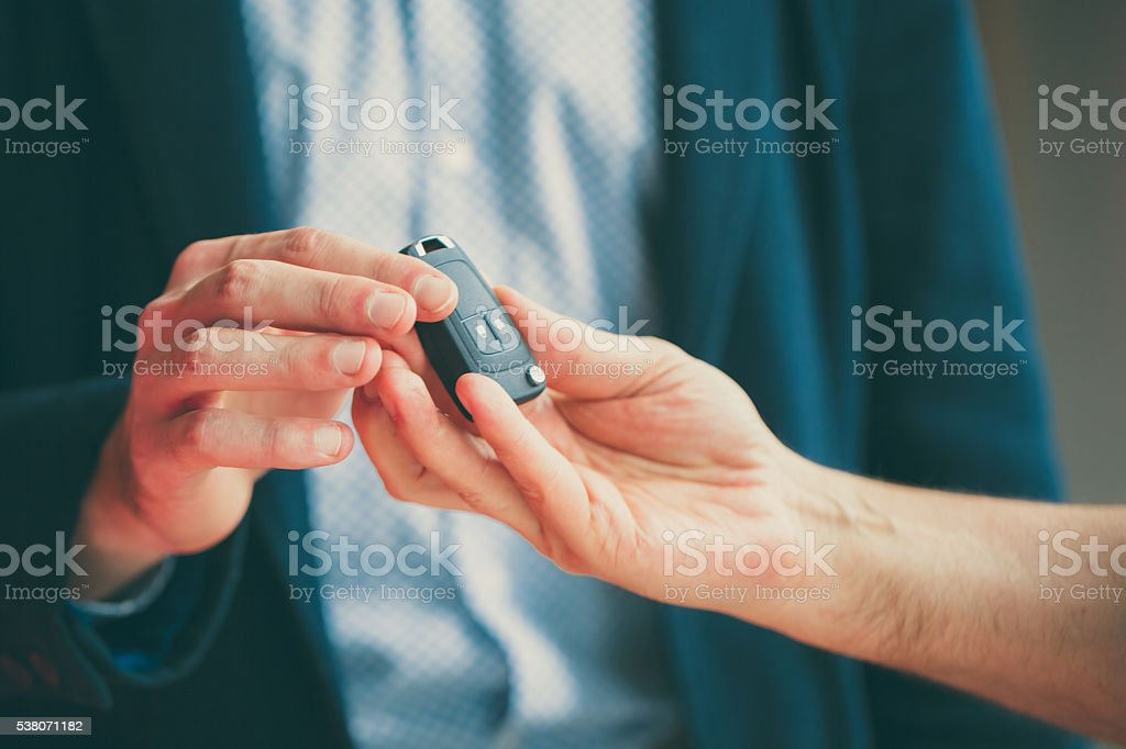 Hand me the keys stock photo