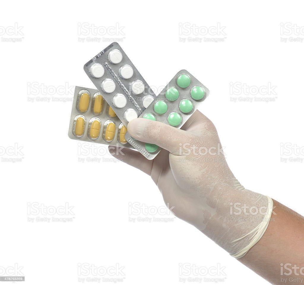 Hand medicine aspirin painkiller tablet pills royalty-free stock photo