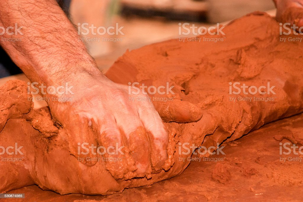 Hand molding clay stock photo