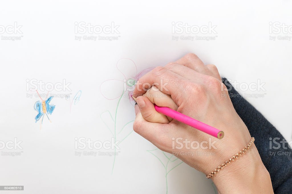 Hand mom and baby draw stock photo