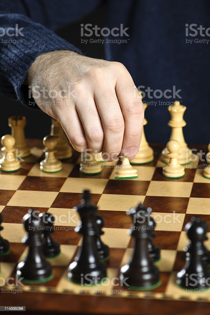 Hand moving pawn on chess board royalty-free stock photo