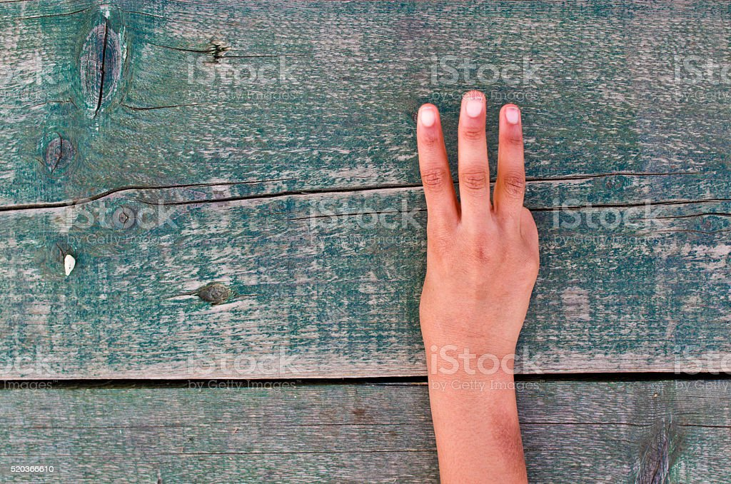 hand, numbers and wood stock photo
