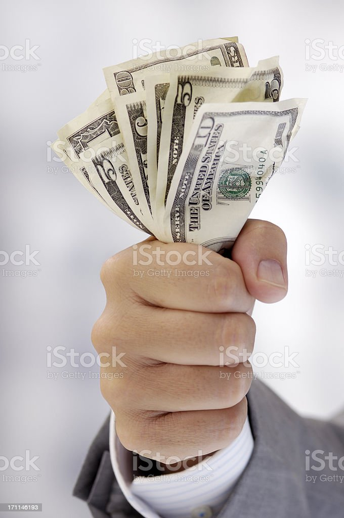 Hand of a businessman with dollar notes royalty-free stock photo