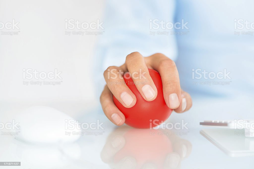 Hand of a Businessman With Stress Ball stock photo