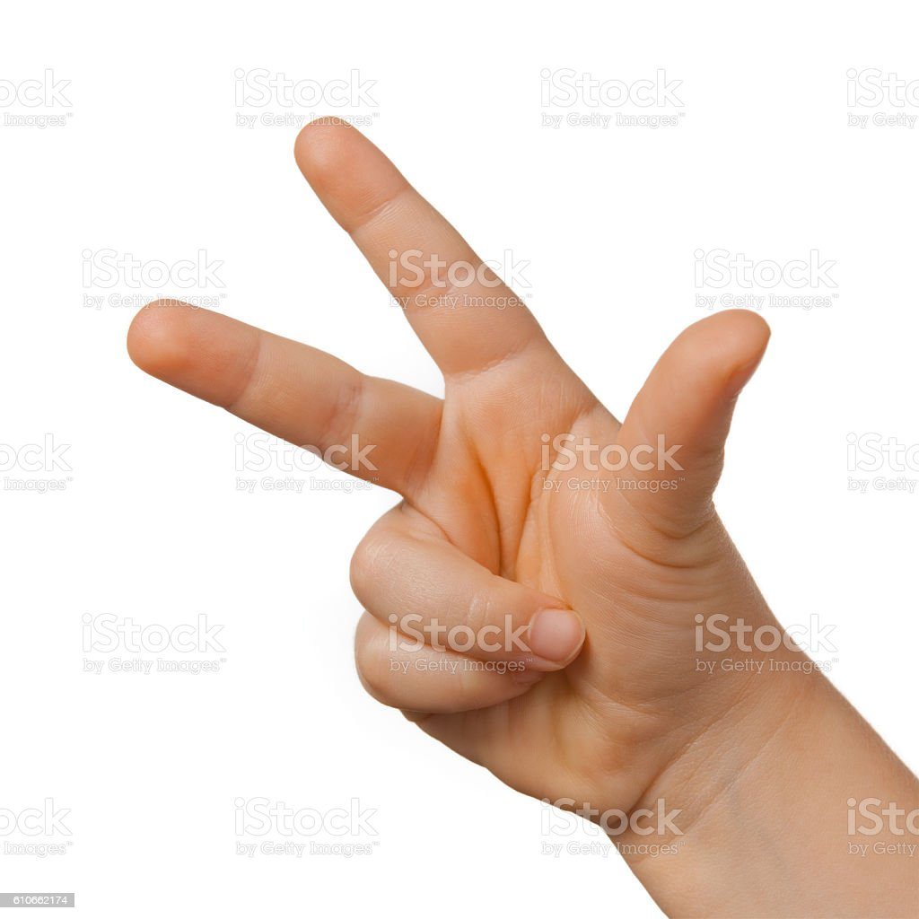 Hand of a child making number three on white background stock photo