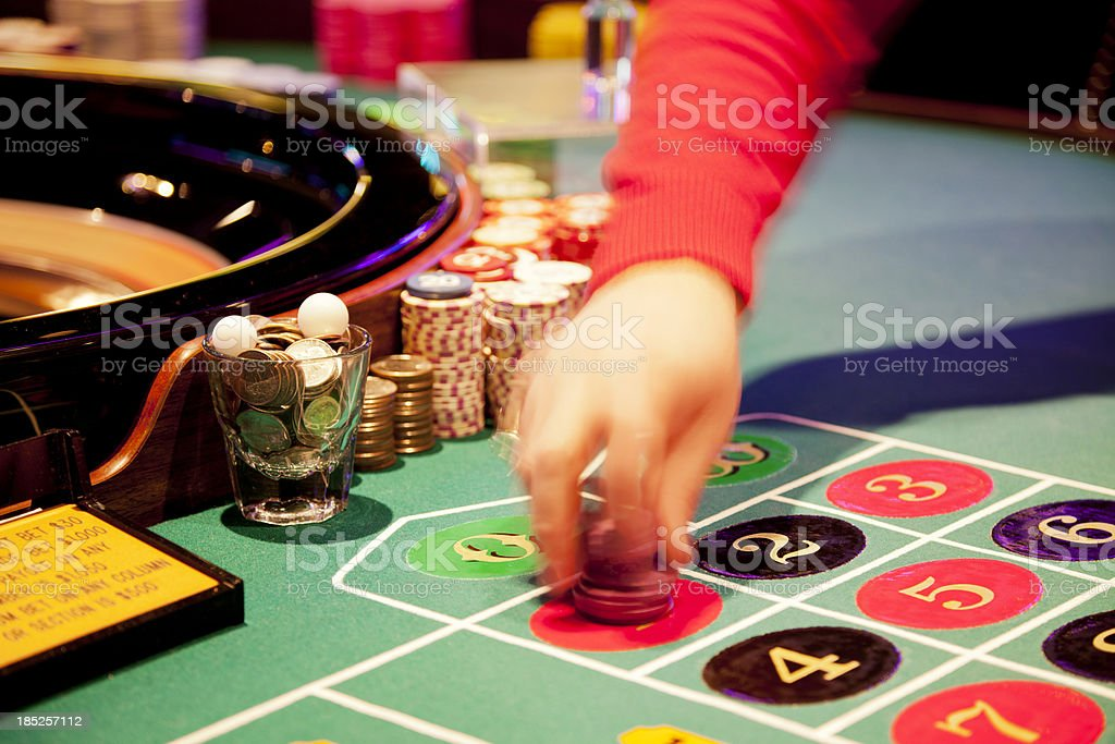 Hand of a dealer at the roulette table royalty-free stock photo