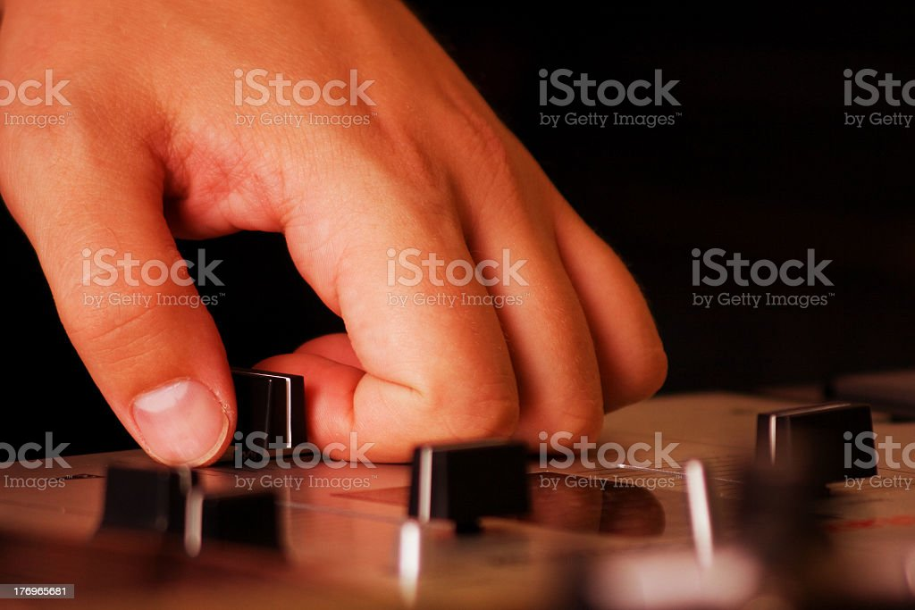 Hand of a dj adjusting the crossfader stock photo