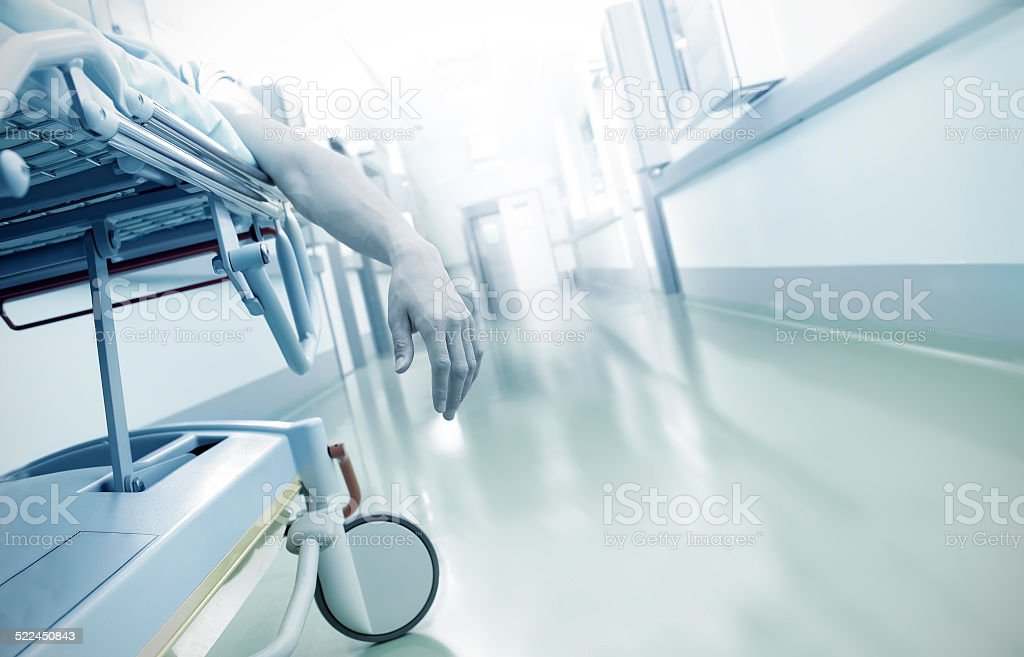 Hand of a dying patient lying on a mobile bed stock photo