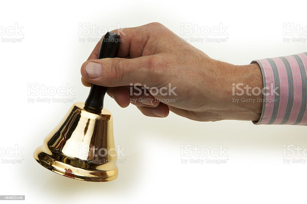 Hand of a man with brass bells stock photo