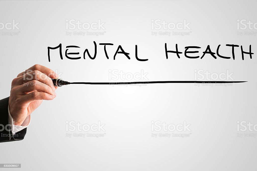Hand of a man writing Mental health on virtual screen stock photo
