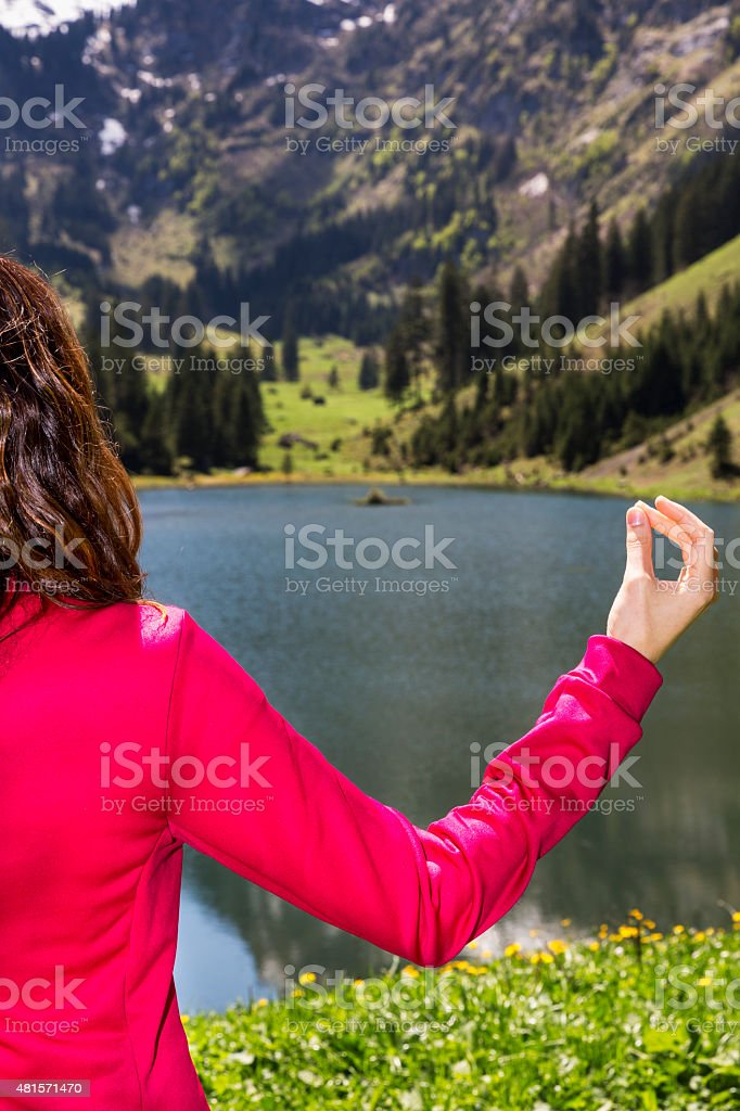 Hand of a meditating woman stock photo