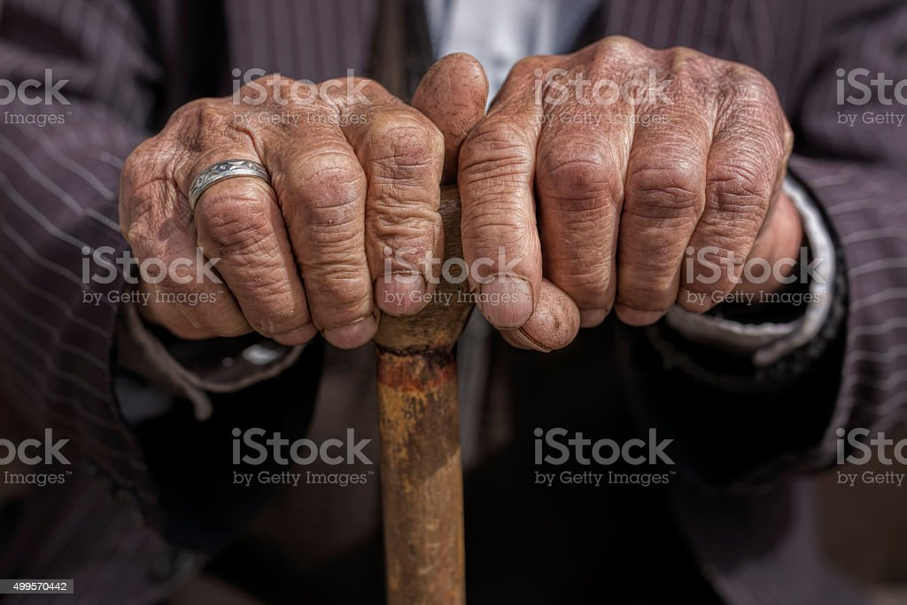 hand of a old man holding a cane stock photo