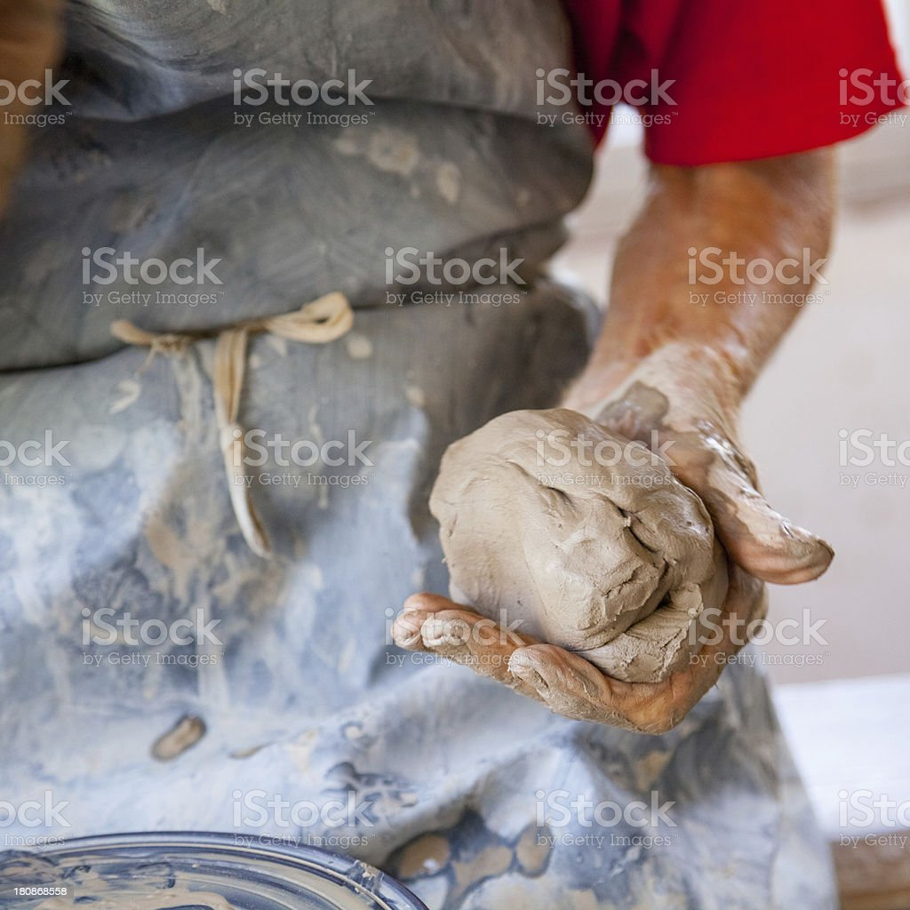 hand of a potter with clay stock photo