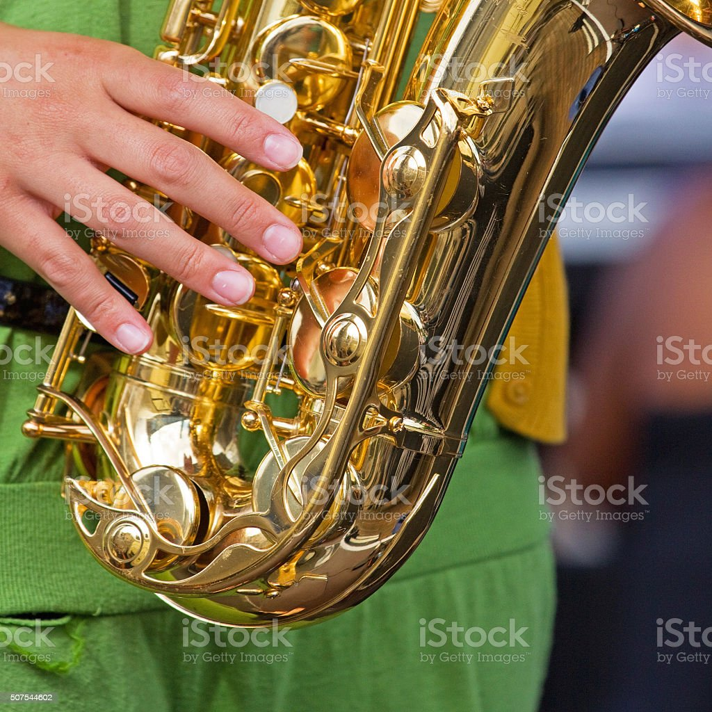 Hand of a saxophonist at play stock photo